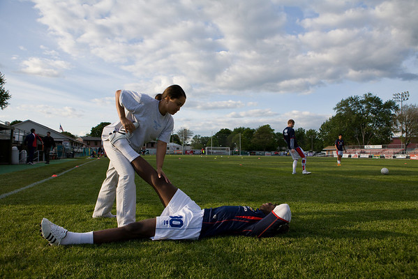 Gary Brooks gets treatment from trainer Val Porter during warm-ups