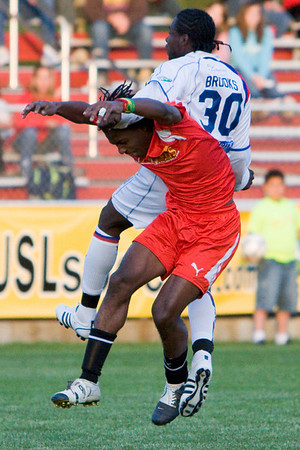 Gary Brooks tangles with Anthony Augustine in the air