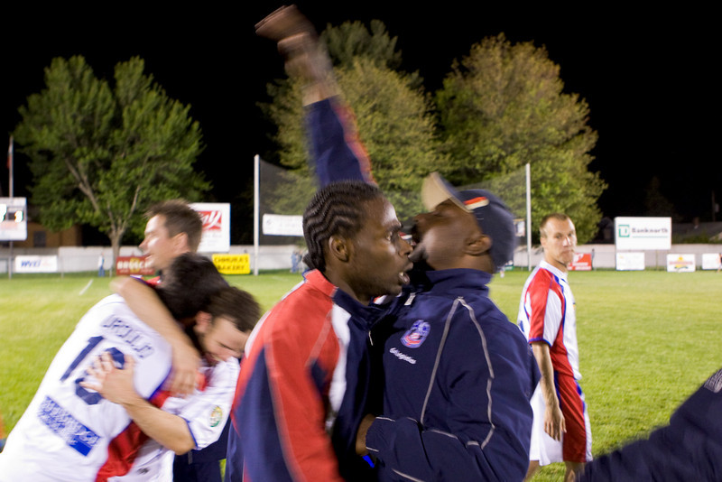 Gary Brooks, who had been sent off on 59 after scoring two goals, is back on the pitch celebrating the win