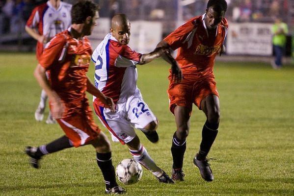 Carlos Morales tries to beat two defenders