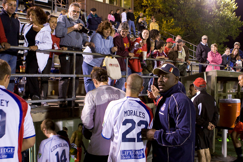 Pioneers fans discuss the finer points of the match with the Palace coaches and players