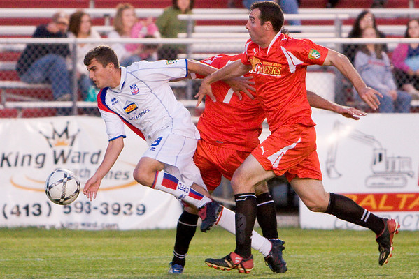 Pat Healey is sent flying as he breaks into the penalty area (a penalty was awarded)