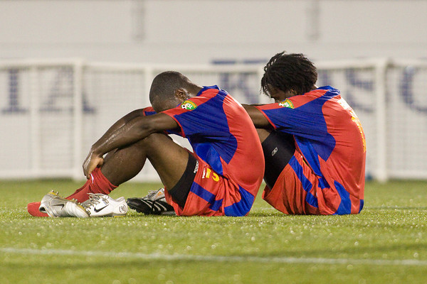 Alex Ughiove and Gary Brooks dejected after the final whistle