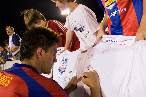 Sergio Flores signing autographs after the match