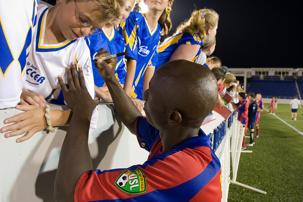 Mathew Mbuta signing autographs after the match