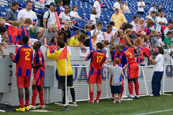 Palace players sign autographs for the fans