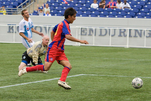 Harold Urquijo dummies the goalie for Palace's second