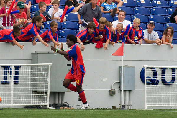 Gary Brooks celebrates his goal, Palace's third, with the fans