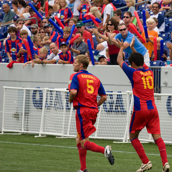 Harold Urquijo celebrates with the fans after scoring Palace's second