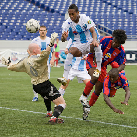 Matthew Mbuta (bottom right) watches his stooping header beat the Wilmington 'keeper for Palace's first goal of the afternoon