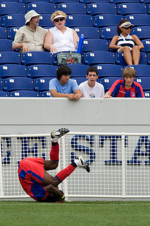 Gary Brooks can't match Matthew Mbuta's goal celebration, ending it with a pair of fairly unimpressive somersaults