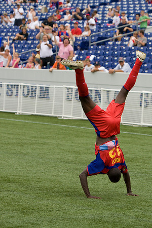 Matthew Mbuta celebrates Palace's first goal of the match (the cartwheel is followed by a hands-free backflip!)