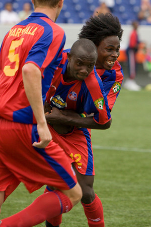 Gary Brooks tries to prevent Matthew Mbuta from celebrating his goal