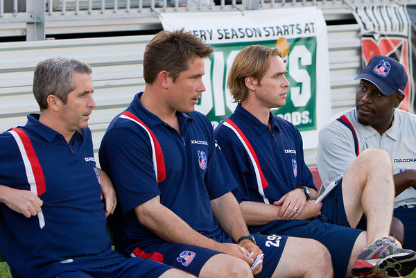 UK academy director, Paul Lowe (left), sits with the Palace USA bench.