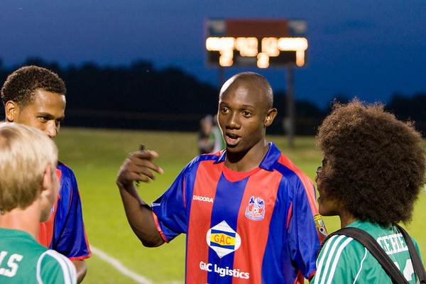 Mathew Mbuta talks to the ballboys.