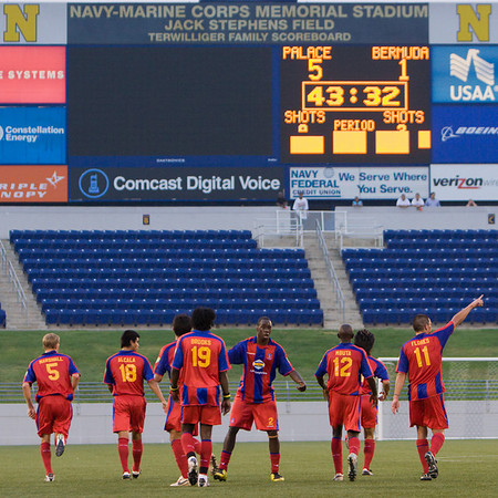 The Palace team heads back to their own half as they finish celebrating going up 5-1 courtesy of Sergio Flores