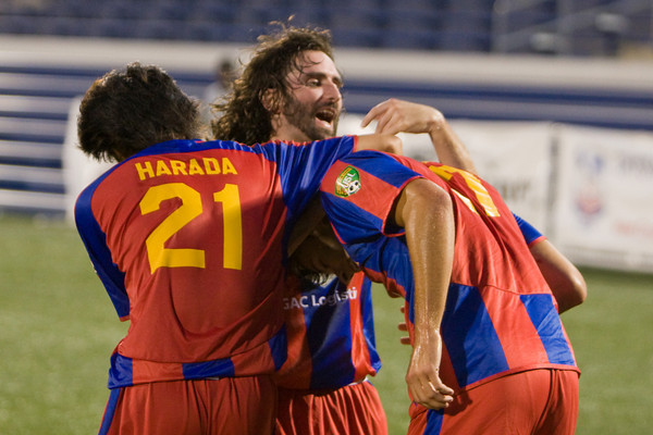 Bryan Harkin and Shintaro Harad celebrate with Andrew Herman after scoring his first goal of the season