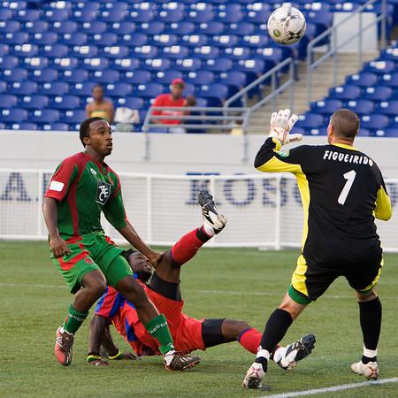 Gary Brooks' deft lob beats Bermuda's goalie to make it 3-0 Palace