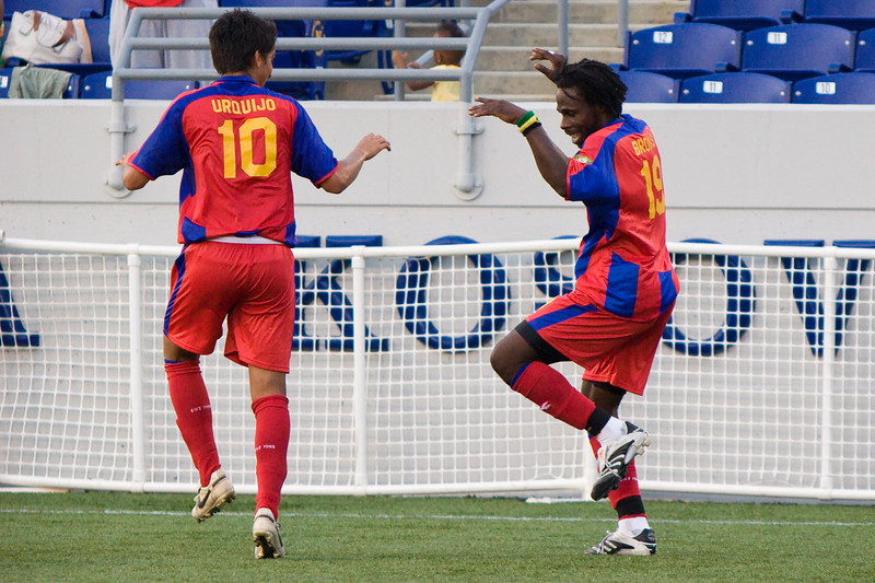 Harold Urquijo joins Gary Brooks in celebrating his first goal of the match