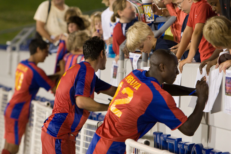 Matthew Mbuta, Rob Fucci and Harold Urquijo sign autographs