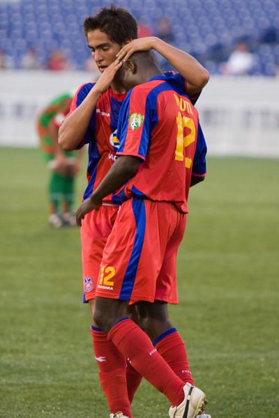 Harold Urquijo congratulates Matthew Mbuta on his second of the game