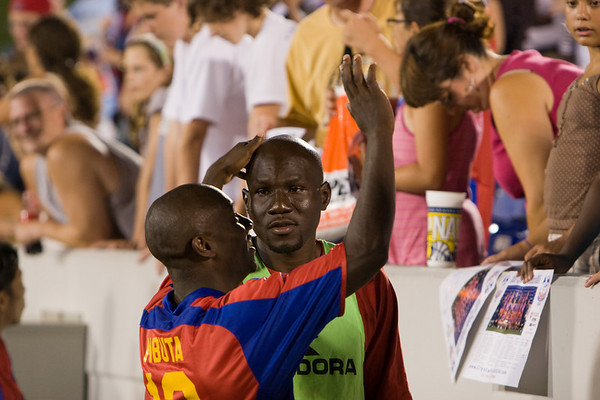 Matthew Mbuta and Ibrahim Kante celebrate with the fans