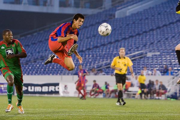 Josh Alcala tries to lob Bermuda's goalie