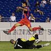 Josh Alcala beaten to a through ball by Bermuda's 'keeper.