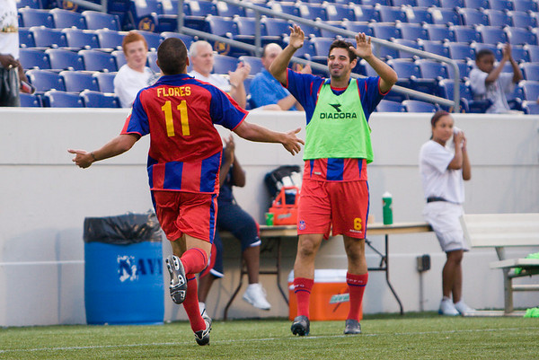Sergio Flores celebrates with Robert Fucci on the sideline