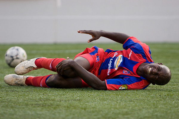 A worrying moment for Palace as Matthew Mbuta is tackled hard - he left the field for five minutes of treatment