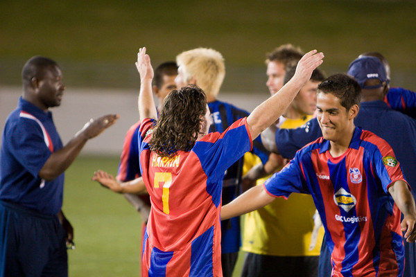 Harold Urquijo and Bryan Harkin celebrate after the match