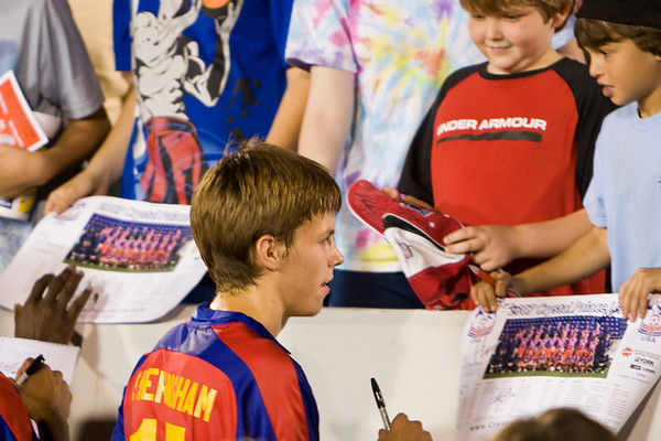 Charlie Sheringham signs autographs after the match