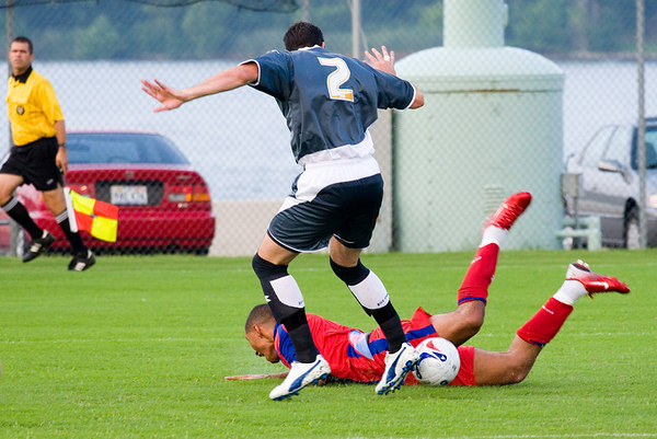 Jay Bothroyd knocked down by Palace USA's big centre-back, Marcus Gross.