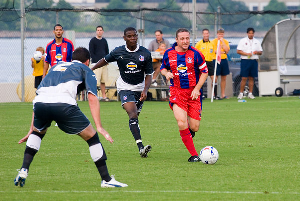 Michael Hughes goes on a mazy run from the right with Maurice Edu in pursuit.