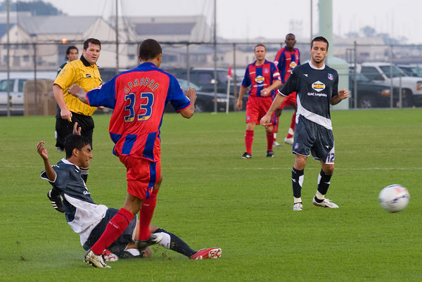 Palace USA defender AJ Delagarza takes the ball off Lewis Grabban's toes in a very physical first half.