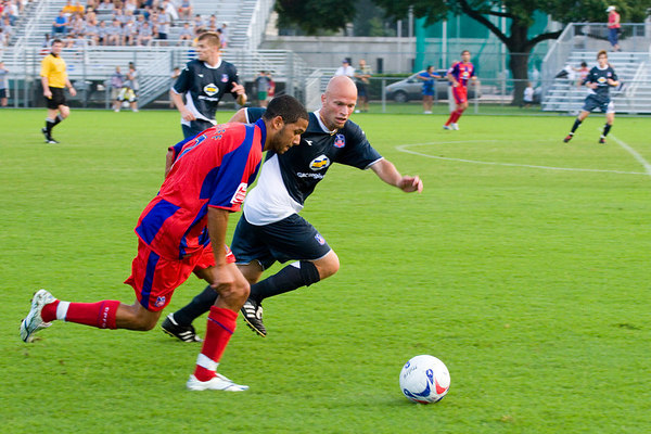 Jobi McAnuff tries to beat Todd Hicks.