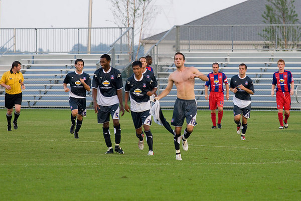 Rade Kokovic continues his shirtless goal celebration while his team-mates have a bit of a chuckle.