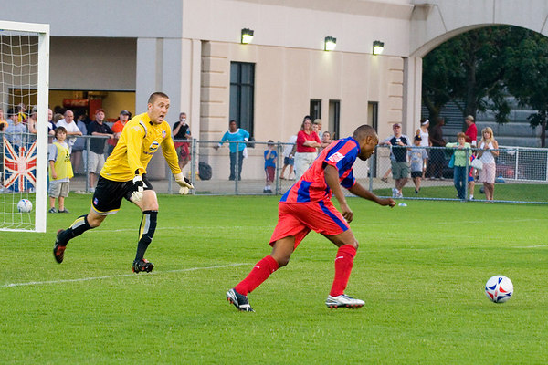 Chris Seitz charges out of his goal to close down an unmarked Clinton Morrison in the box.