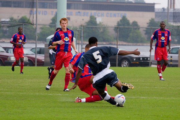 Palace USA's no. 5 and Jay Bothroyd go after a loose ball while Arron Fray, Ben Watson and Leon Cort watch.