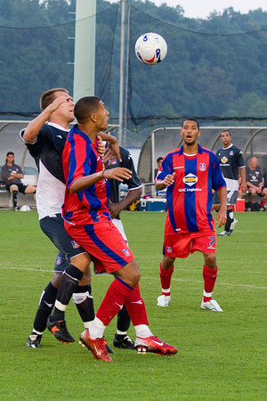 Jay Bothroyd fends off Dan Lader as he thinks about laying off a long ball, with Jobi McAnuff in attendance.