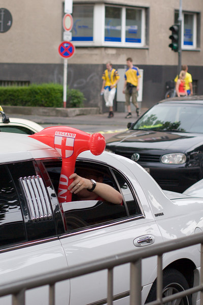 England fan with inflatable hammer heading to the Sweden game in a white limo.