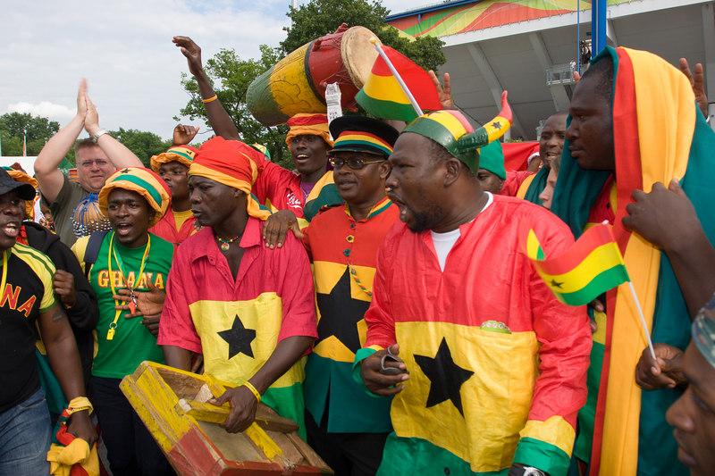 Ghana fans celebrate their victory over the USA at Nürnberg stadium.