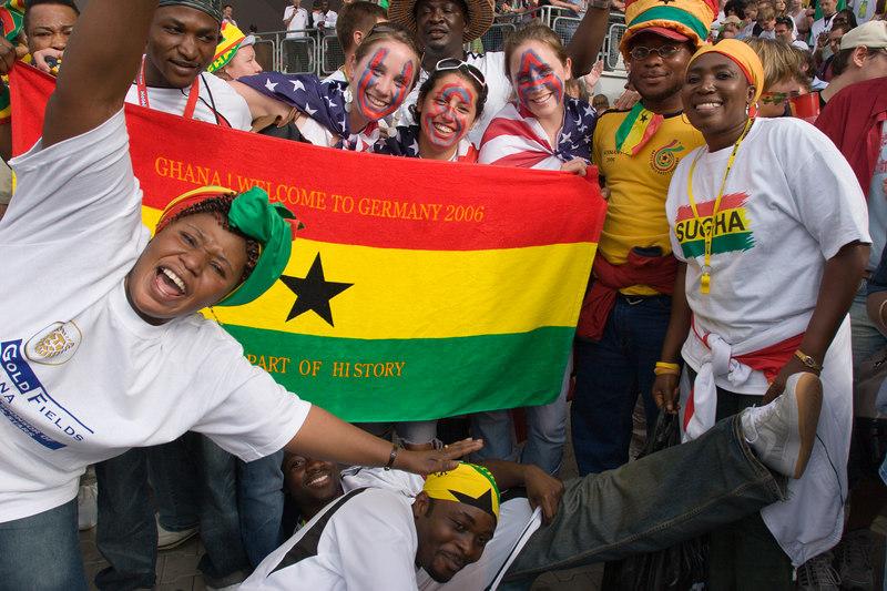 Ghana fans celebrate their victory alongside USA fans at Nürnberg stadium.