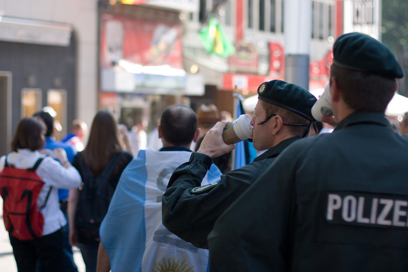 Köln police enjoy their Starbucks coffee while keeping an eye on the contingents of boisterous Germany and England fans.
