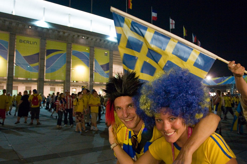 Sweden and Paraguay fans leave the the Olympiastadion.  (Who knew the Swedes did afros?)
