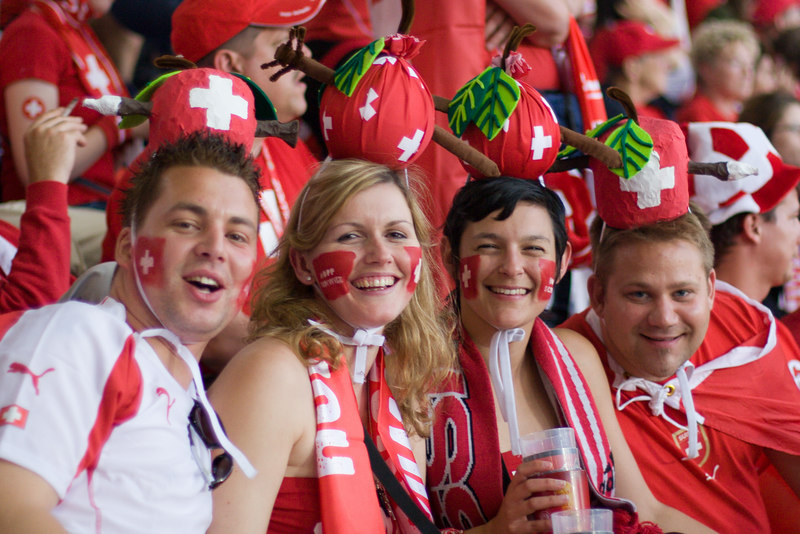 The Switzerland fans, paying tribute to one of their most famous sons, William Tell, are delighted with the 1-0 lead at half-time against South Korea.
