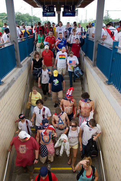 "USA (or is that ""U.A. of S.?) and Ghana fans arrive at the stadium station in Nürnberg."
