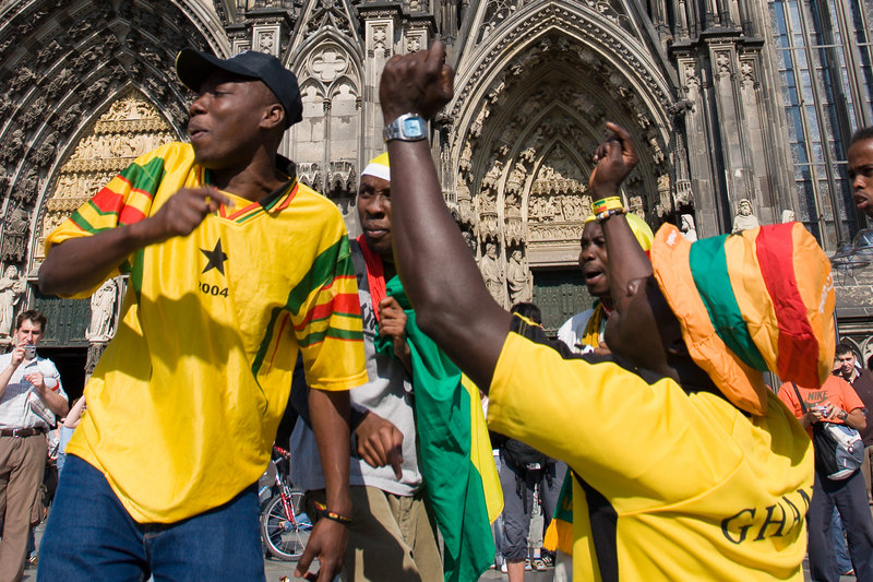 Ghana fans in front of the Dom (Cathedral) in Köln, anticipate victory a few hours before their game there with the Czech Republic. Ghana ended up winning 2-0.