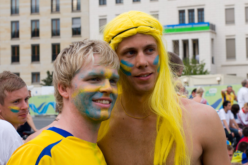 Sweden fans pose for a photo on the Fan Mile in Berlin.