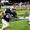 Record-Eagle/Keith King<br /> Traverse City St. Francis' Adam Armour runs with the ball after a catch against Saginaw Nouvel Friday, October 5, 2012 at Thirlby Field in Traverse City.